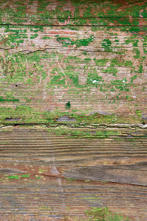 upkeep: Wood texture with painting color peeled off. Flaking green paint - wood background texture.