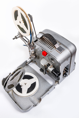 motion picture: Retro old reel movie projector for cinema. A reels of motion picture film on a white background. Analogue movie projector with reels isolate on white background.