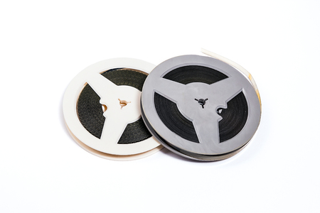 motion picture: Two reel of motion picture film on a white background. Old film strip isolated on white background.