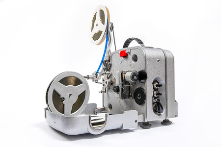 silent film: Retro old reel movie projector for cinema. A reels of motion picture film on a white background. Analogue movie projector with reels isolate on white background.