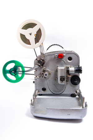 cine: Retro old reel movie projector for cinema. A reels of motion picture film on a white background. Analogue movie projector with reels isolate on white background.