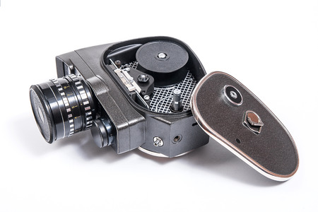 filmmaker: Old movie camera with lens isolated on a white background.