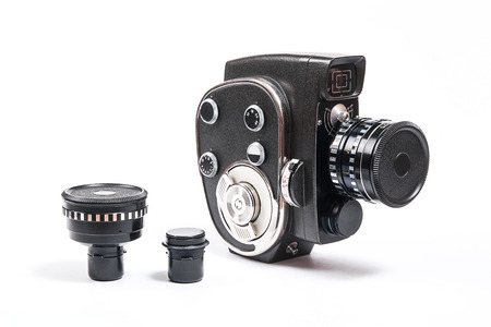 filmmaker: Old movie camera with lens and two additional lens isolated on a white background.