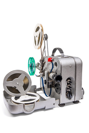 Retro old reel movie projector for cinema.  A reels of motion picture film on a white background. Analogue movie projector with reels isolate on white background.