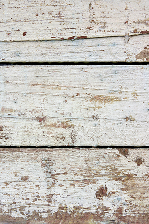 upkeep: Wood texture with painting color peeled off. Flaking paint - wood background texture.