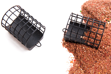 Close up view of fishing feeder. Dry feed for carp fishing as background for different fishing feeder.