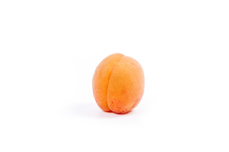 Close up view of ripe whole and halved apricots isolated on white background. Healthy food concept. Harvest time.