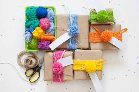 surprise box: Preparation for the holiday. Gifts wrapped in kraft paper. Confetti.