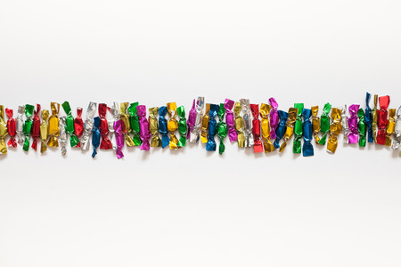 wrappers: Candy colored wrappers on a white background.