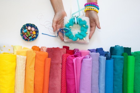 Rolls of bright colored fabric on a white background. Imagens