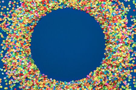 Classic Blue. Color of the Year 2020. Colored confetti on a blue background.