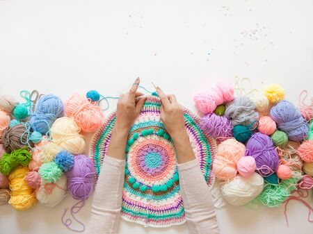 Colored balls of yarn. View from above. Rainbow colors. All colors. Yarn for knitting. Skeins of yarn. Фото со стока