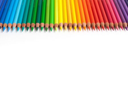 Crayons - colored pencil set loosely arranged on white background. colored pencils arranged exactly in a row.