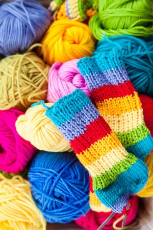 Bright colored yarn for knitting in a basket.