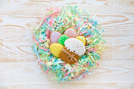 Easter homemade gingerbread cookie. Birds nest Easter made from colored paper. Russian, Orthodox Easter.