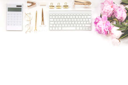 Office supplies are gold and white. Concept female desktop.