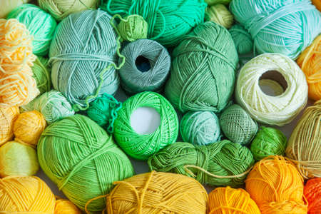 Colored balls and skiens of yarn for knitting. Top view. Rainbow colors. Color radial, round gradient.