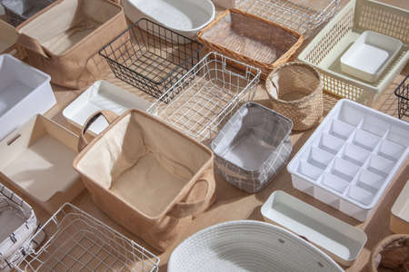 Flat lay of Marie Kondos storage boxes, containers and baskets with different sizes and shapes