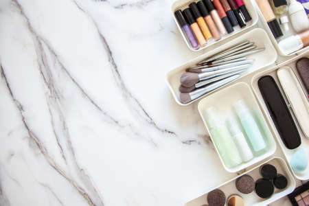 neatly placing cosmetic and vanity items in MUJIs PP makeup storage boxes.