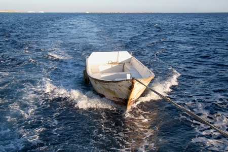 A boat at sea on a tow