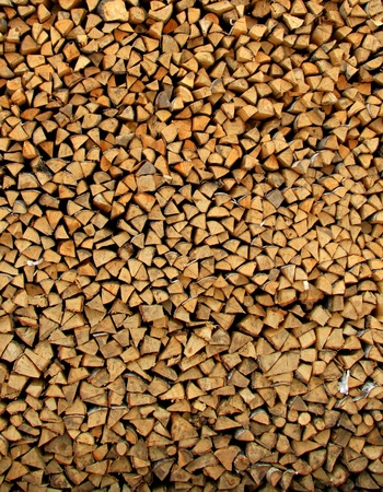 Wooden logs stacked in series Stock Photo