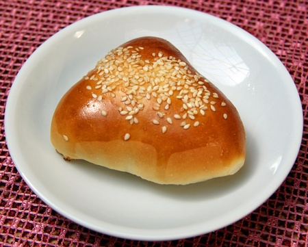 bun lying on a plate