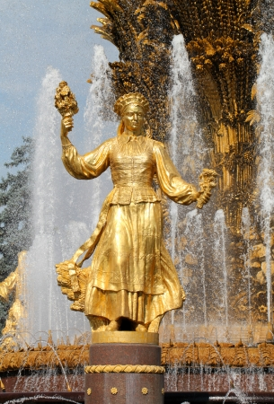 Girl with a fountain of friendship of peoples Lithuania in Moscow at ENEA