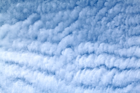 White feather clouds in the sky Stock Photo