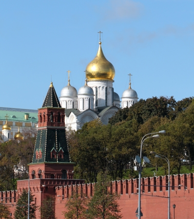 Moscow Kremlin tower on the background of the cathedral photo