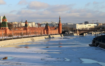 Moscow Kremlin in winter photographed on a background of the Moskva River covered with ice photo