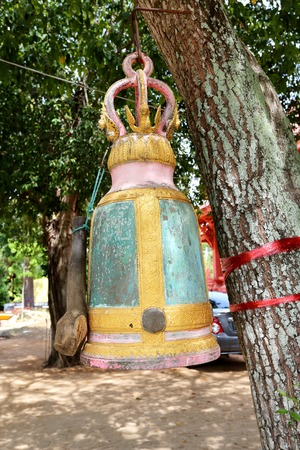 bell hanging on a tree in a Buddhist temple