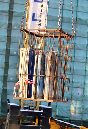 gas cylinders are transferred in an iron cage on tap