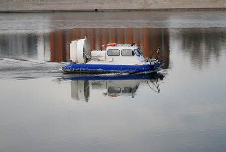 Boat hovercraft air engine floats on the river Moskva photo