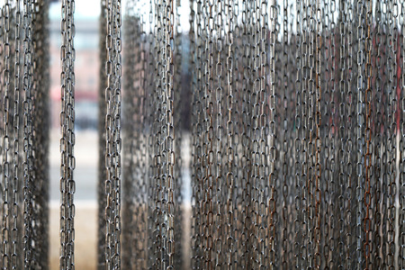 chained link: Texture of hanging chains on the background of the river