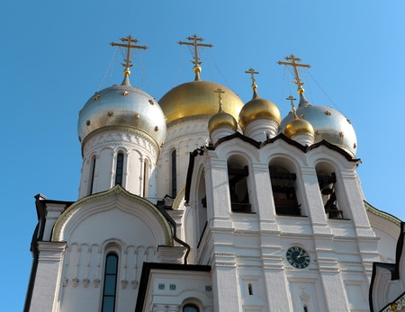 Russian orthodox church with gold domes photographed close-up Stock Photo