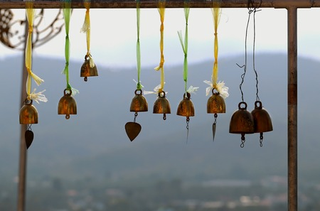 Golden bells hanging mountains in the background