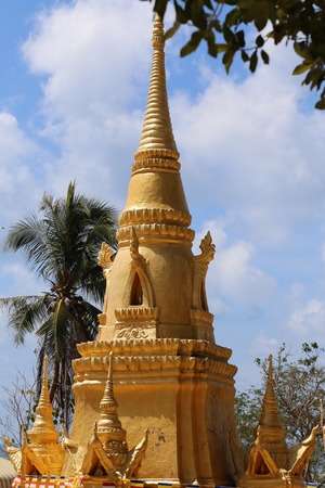 buddhist temple roof: The roof of a Buddhist temple of the snake in Thailand on Koh Samui on the background of blue sky