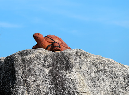 embossment: Rock with a statue of a turtle on the beach in Thailand on Koh Samui Stock Photo