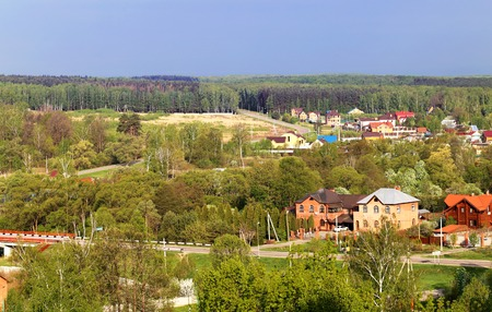Beautiful landscape of the Russian village with forests and fields photo