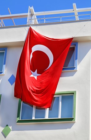 beautiful allah: Beautiful Turkish flag hanging on the building Stock Photo