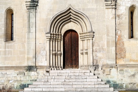 catholic church: Ancient door in the Church photographed close up Stock Photo