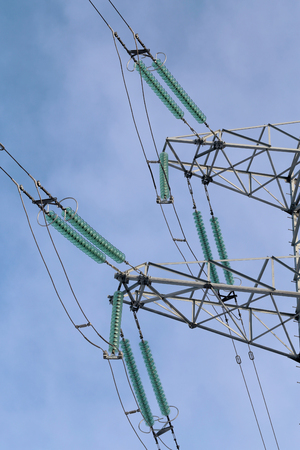 voltage: High voltage electric wires on the tower