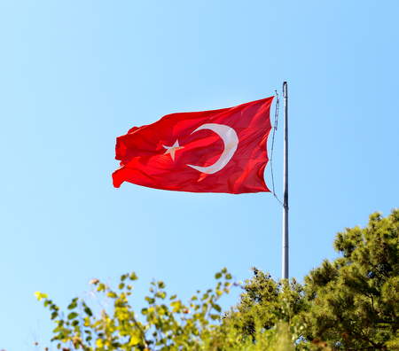 Beautiful red Turkish flag on a background blue sky