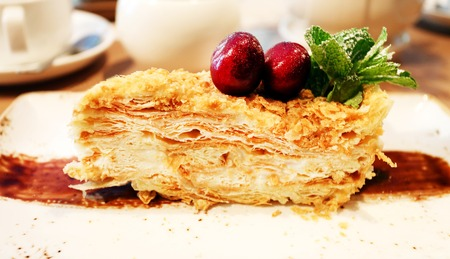 Photo big piece of delicious cake Napoleon
