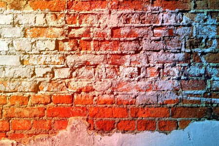 Beautiful texture of red brick covered with white plaster