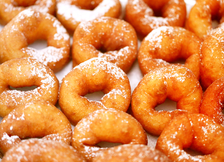 Delicious rings donuts with powdered sugar photographed in close-up Stock Photo