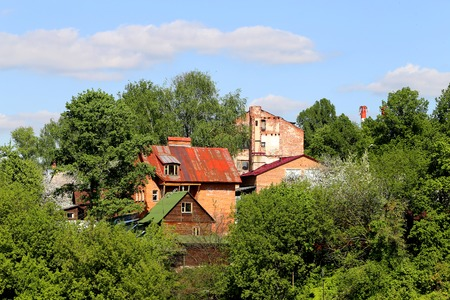 Brick house among the trees in Russia Stock Photo