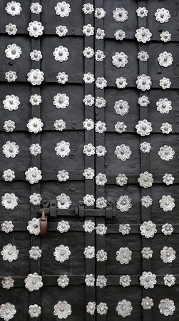 Iron door with flowers for the entrance to the temple photographed in close-up Stock Photo