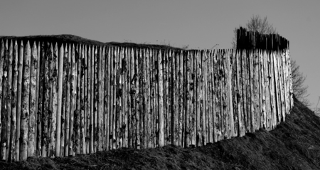 Photo background old wooden fences on the hills in the spring Stock Photo