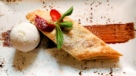 Photo of delicious apple strudel and ice cream in a cafe Stock Photo